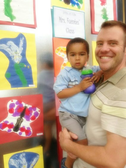 """Nolin """"proudly"""" showing off his Easter Lilly Painting at his school art show."""